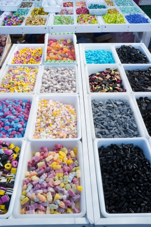 All sorts of candy at a market stall photo