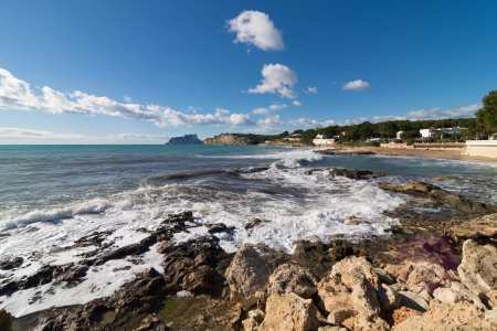 breaking in: Beautful rocky coastline with waves breaking  in Moraira, Costa Blanca, Spain