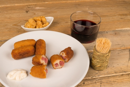 Portion of croquettes with ham and bechamel stuffing photo