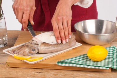 skinning: Skinning a fresh cuttlefish before cooking