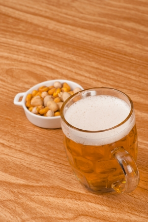 andalusian cuisine: Beer on bar counter with  a crunchy appetizer Stock Photo