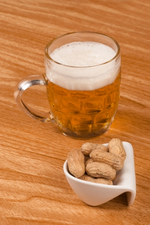 andalusian cuisine: Tankard of lager and some shelled peanuts