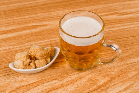 stein: Stein of beer served with a portion of pork rinds Stock Photo