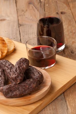 andalusian cuisine: Still life with traditional morcilla, a Spanish black pudding