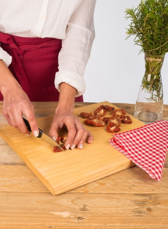 Sundried tomatoes, a Mediterranean ingredient, being chopped