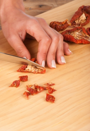 ingedient: Sundried tomatoes being chopped, a  Mediterranean classic
