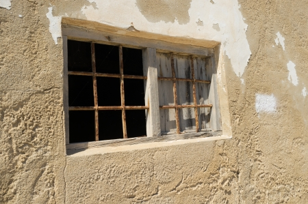 derelict: Grunge window on a derelict building exterior