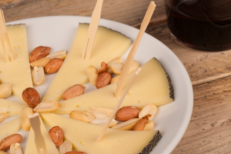 andalusian cuisine: Manchego, traditional Spanish sheep cheese, served with red wine Stock Photo
