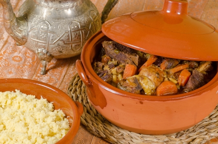 traditiional: Closeup take of fresh couscous in traditiional clay pots