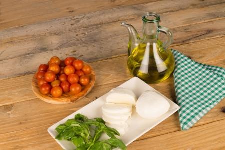 Still life including mozzarella and salad ingredients photo