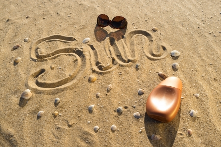 sunblock: Beach sand and sunbathing related objects, a concept