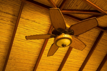 Wooden ceiling fan in classic tropical style photo