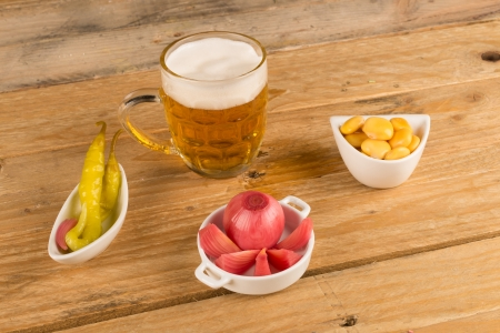 Beeer with assorted tapas, all of them pickled photo