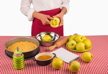 femal: Femal hands peeling apples to prepare a traditional pie