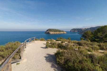 Coastal trail running along the scenic cliffs of Javea, Costa Blanca photo
