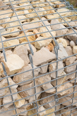 Gabion retaining wall with stacked riprap photo