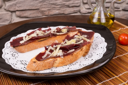 air dried: Traditional Spanish pintxo with air dried beef meat and cheese Stock Photo