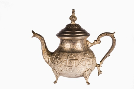 Ornate oriental  pewter teapot isolated on white