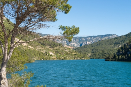 forested: Ulldecona reservoir surrounded by  pine forested mountains