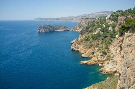 Rocky Mediterranean coastline around Cabo de la Nao, Javea, Spain photo