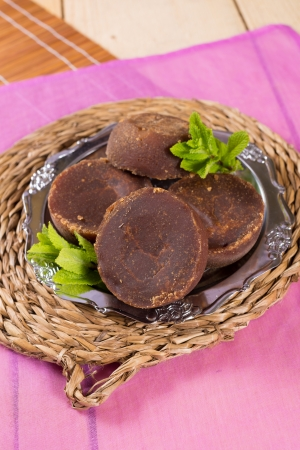 panela: A plate with pieces of raw brown sugar