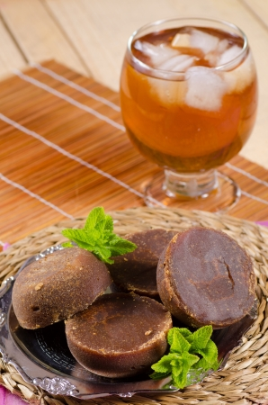 Traditional Latin American drink prepared with raw brown sugar, panela   photo