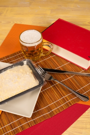 frozen food: Bachelor dinner kit  a beer, frozen food and a book