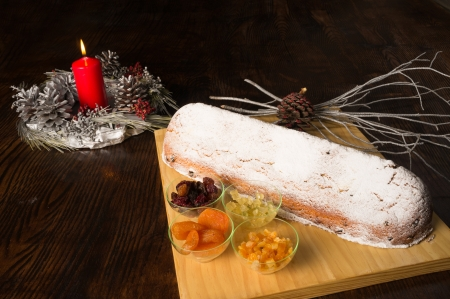 Traditional German Christstollen surrounded by festive decoration photo