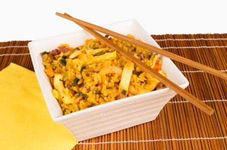 bamboo mat: Bowl with Singapore rice on a bamboo mat