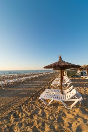 recieve: Sunny Mediterranean beach ready to recieve its guests Stock Photo