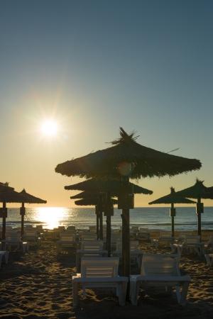 sunshades: Sunrise on the beach as seen through the sunshades