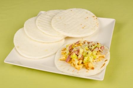 Serving of freshly made arepas, Latin American food staple photo