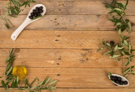 Olive  branches,fruit and oil,a  background photo
