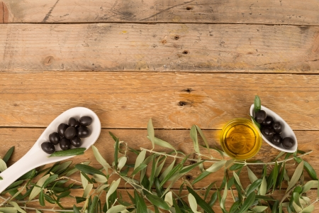 Olives, branches, and olive oil, a food background photo