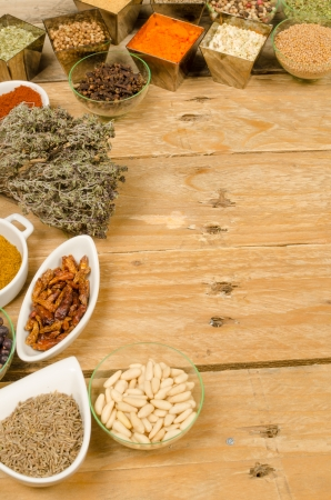 pine kernels: Assorted spices on an old wooden table