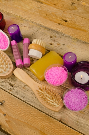 bath salts: Bath salts and soap on a rustic wooden backround