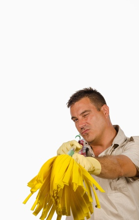 drudgery: Guy pointing at camera with his yellow mop Stock Photo