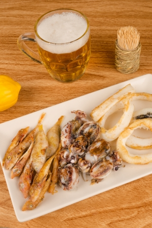 andalusian cuisine: A traditional fish appetizer and a beer to wash it down