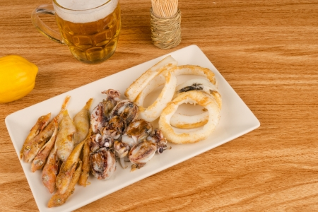 andalusian cuisine: Assorted fried fish and a glass of beer, a Spanish tapa Stock Photo