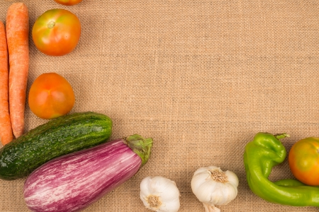 Assortment of fresh vegetables arranged as a food background photo