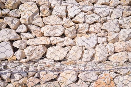 gabion: Full frame take of a gabion wall, a construction techniqe