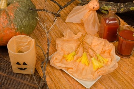 broomsticks: Halloween snack for children, funny cheese broomsticks Stock Photo