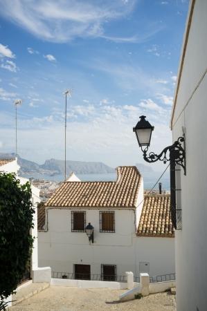 altea: Traditional Mediterranean village street , Altea,  Costa Blanca, Spain Stock Photo
