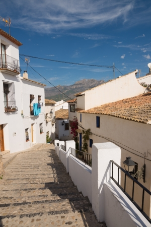 altea: Stairs leading down a street of Altea old town, Costa Blanca, Spain Stock Photo