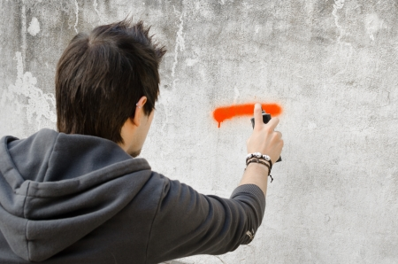 Graffiti artist about to start spraying a wall Imagens