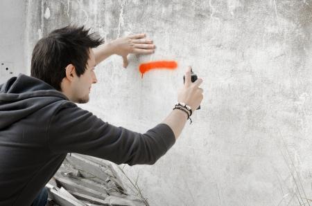 Graffiti artist about to start spraying a wall
