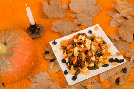Plate of Halloween pasta with spooky shapes, a seasonal kid meal photo