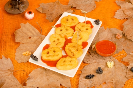 Hallloween kid party snack, cruchy potato appetizer in  spooky shapes photo
