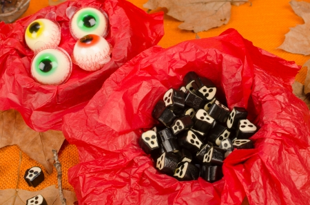 Assorted Halloween candy, treats for kids in spooky shapes photo