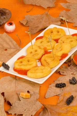 Crispy fried Halloween potato snack, food for a kid party photo